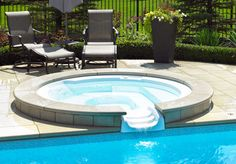 Spill into the pool - Hot Tub Ideas and Inspiration   WHATEVER SHAPE OR SIZE YOU'RE LOOKING FOR, THIS SPILLOVER HOT TUB IS A GREAT ADDITION TO A BEAUTIFUL BACKYARD.  With seating for 4 and boasting 6 hydrotherapy jets, this hot tub is sunken into a beautiful patio and spills over into a stunning inground pool.  #HotTub #Spa #HotTubs #Spas #Design #Idea #Ideas #Inspiration #Inspire #Backyard #Patio #Deck