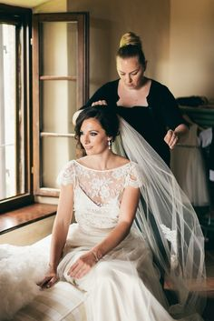 Lois wears the Halfpenny London Iris French Lace jacket worn over a satin camisole with the silk tulle & French lace Annabel skirt, duchess satin sash and flower and lace edged silk tulle veil | Bridal fashion and wedding dresses by Kate Halfpenny