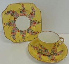 Stunning Art Deco Trio from Carlton Ware with Beautiful hand Enameled flower sprays in a bright pink blues red and mauve on bright yellow ground, British Vintage Dishes, Vintage China, Art Deco, Art Nouveau, Yellow Tea Cups, Shabby Chic Boutique, Carlton Ware, China Patterns, Vintage Shabby Chic