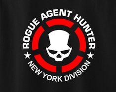 Pícaro agente cazador - inspirado por la división de Video Game Logos, Tom Clancy The Division, Logan Wolverine, Arte Horror, Crests, Order Prints, Rogues, Axe, Soldiers