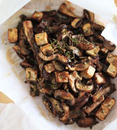 Mushrooms and tofu cooked in parchment with miso and rosemary.