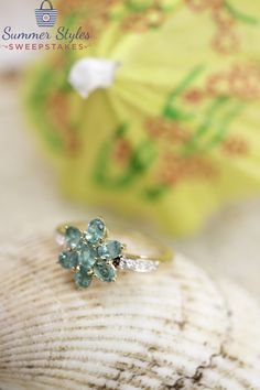 A summer trend we love is floral inspired jewelry! This Emerald ring is absolutely perfect for summer!