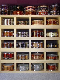 Drummer's colorful well stocked Christmas Dream Closet. -DdO:) http://www.pinterest.com/DianaDeeOsborne/drums-drumming-joy - Idea for a well organized storage area for snare drums, small bongos, tambourines, and other percussion or small musical instruments