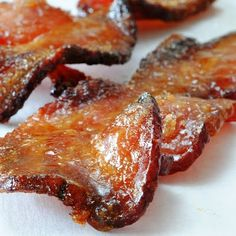 Bacon Candy  Mix 1/2 C maple syrup and 2 Tbs brown sugar.  Add cooked bacon pieces to the mix, spoon bacon into a strainer then quickly put on a baking pan so you don't lose all the syrup mix. Bake 350 for 10 minutes, toss, bake 5 mins more.  Can also add candied almonds for a great snack or can top a salad.  YUM!!