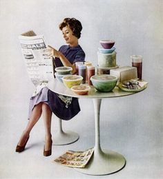 Tupperware ad, 1962. You know what's in those dishes? A suckfest of leftovers. My money says that at least one of them contains a Spam dish, and one of the desserts involves a lime Jell-O mold with pineapple in it.