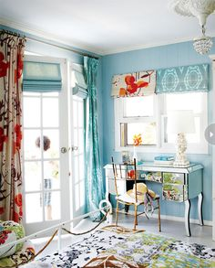 via style at home.  beautiful bedroom. love the use of mixed up textiles with the blue and white and orange.