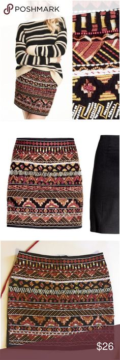"""H&M  Beaded Embroidered Black Brown Mini Skirt 4 H&M Like New Beaded Embroidered Black Brown Mini Skirt  • Sz 4 • 100% cotton Shell •  Fully lined in100% cotton Twill  • Black skirt heavily beaded in colors of tan, browns, brick red,  and deep mustard  • Solid black back • Back zipper with hook and eye and button closure • 13.75"""" waist when flat • 15.5"""" length • Like new condition H&M Skirts Mini"""
