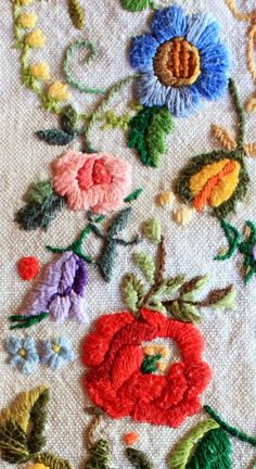 embroidered flowers on vintage linen