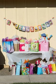 Monthly rainbow banner over her gift table Addys First Birthday Party Rainbow & Unicorn Theme