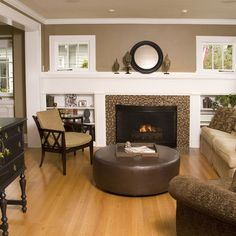 Taupe with light oak floors and fireplace extended across wall with built ins