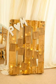 Use wide angle string lights to highlight the table seating plan in your wedding reception. Weave the strand back and forth on a wood pallet and clip the table number cards to the wire. http://www.lightsforalloccasions.com/p-1900-wide-angle-led-string-lights-battery-operated-6-foot-silver-wire-warm-white.aspx
