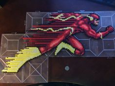 The Flash in Perler Beads next to a quarter.Made in Perler Beads: The Flash Perler Bead Designs, Pearler Bead Patterns, Perler Patterns, Modele Pixel Art, Pix Art, Peler Beads, Iron Beads, Melting Beads, Perler Bead Art