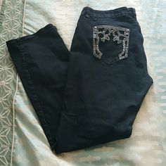 Western jeans I call these cow girl jeans because of the amazing detail on the back pockets, these are super cute ,has slight flare, dark wash, in hreat condition Jeans Straight Leg
