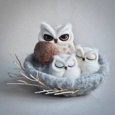 OWL NEST Needle felted sculpture of mother owl and two sleeping baby owls. Beautiful rustic decoration, perfect during Spring/Easter season.  The owls are needle felted tightly. It takes several hours to finish one detailed bird. They are made from several types of wool in various blended shades. Position of the owls can be adjusted as they are not fixed into the nest. The nest is a soft needle felted structure made from grey and beige animal wool, decorated with small twigs. Size: whole...
