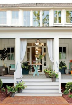 ginmar; designmeetstyle:  Gorgeous front porch that really welcomes you home. We loved the addition of the outdoor curtains and entryway tab...