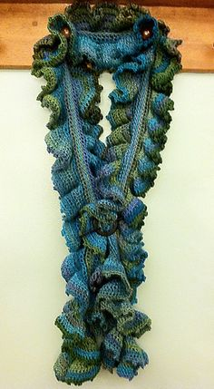 Ravelry: Tidal Trend pattern by Merri Purdy. This ruffle scarf is an eye-catching work of art that will draw compliments wherever you go! It is worked in the round with a fun picot edging. Wear it with your favorite coat or as an accessory to your everyday indoor wear.