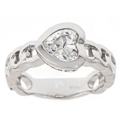 """""""Saved Heart"""" Clear Stone Purity Ring - Purity Rings - Rings   Cornerstone Jewelry I like how this ring is positioned, neither given nor kept to oneself, just waiting."""
