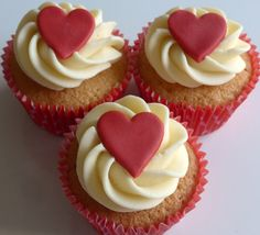 Valentines Cupcakes - vanilla sponge cupcakes, filled with jam and topped with a vanilla buttercream swirl and a fondant heart.