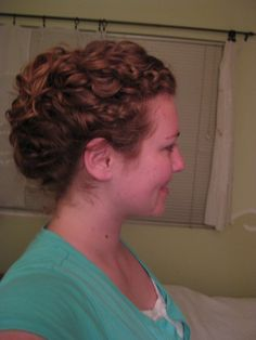 This is a loose french-twist with the ends left out to show off the curls.