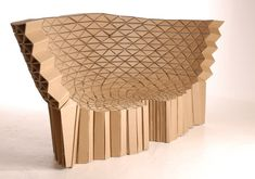 Cardboard Furniture by Lazerian Studios designed by Hopkins and Sweeney. This sofa was inspired by wasp nests and sea critters.