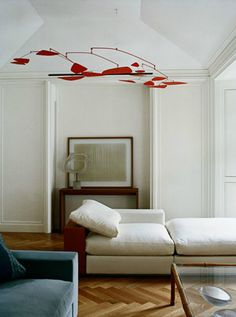 Calder mobile, herringbone floor, sculpture, and muted colors. Another room that would make Mom swoon.