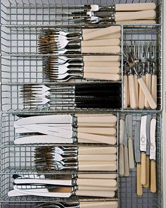 Everyday Flatware    Martha likes organizers with rectangular compartments (rather than spoon- and fork-shaped compartments) for the French ivory flatware she uses daily. Similar wide-mesh chrome drawer trays, organize.com.