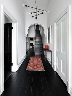 black wood floors, white walls and ceiling Black Floorboards, Black Wood Floors, Black Floor Paint, Dark Flooring, Painted Hardwood Floors, Painted Floorboards, Laminate Flooring, Hallway Flooring, Flooring Ideas