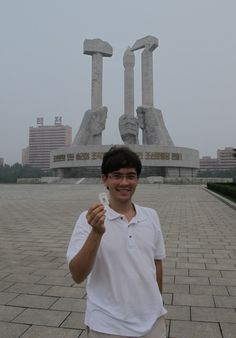 """Geocaching Steps into North Korea - Warren Rieutort-Louis, rieuwa, in North Korea at the """"Monument to Party Foundation"""""""
