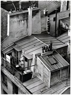 André Kertész; On Reading series, 1926 Latin Quarter, Paris