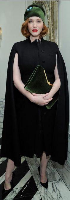 Who made Christina Hendricks' black cape, gold clutch handbag, and green velvet handbag?