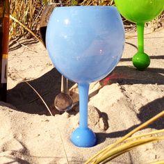 The beach glass (.com). Spike underneath holds glass up. Floats. $9.50 each.