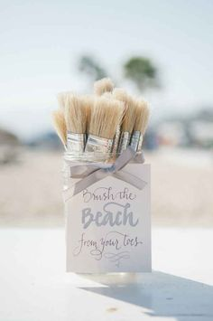And provide brushes so your guests can brush the sand off of their toes.