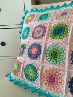 Crochet granny cushion. With link to granny tutorial.
