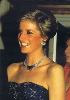 The always beautiful Diana, Princess of Wales attended a Gala performance of Cinderella at the Royal Opera House in Covent Garden in London on December 16, 1987. She looked stunning in a midnight - blue silk - tulle, strapless dress decorated with daimant stars by designer Murray Arbeid.
