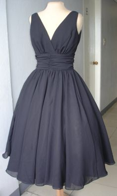 A very elegant 50s style cocktail dress. Classic design in black chiffon. Can be customized like many others in our shop. Any size welcome.. $255.00, via Etsy.