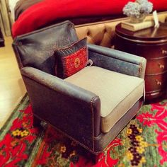Love this little chair with it's aged leather and fabric combo, and nailhead trim.
