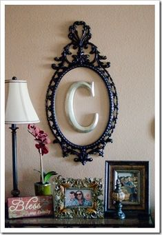 Simple cute idea......empty frame/mirror and initial. decor-i-love