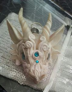 Image result for clay dragon head wall mount