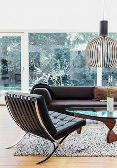 Living room with modern design classics, including Mies van der Rohes Barcelona…