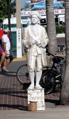 Florida Memory - Key West Street performer on Duval St. - right behind one can take the 'glass bottom' boat tours about 2 - 3 hrs. - MR