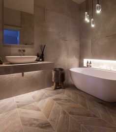 Janey Butler Interiors - luxury spa style bathroom design with herringbone wood & concrete effect wall tiles