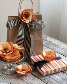 i have to figure out paper flowers...because  i die for the striped ribbon with craft paper!