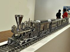 """Jim Beam - J.B. Turner Train"" (stainless steel), by artist Jeff Koons at the Whitney Museum of American Art, New York City. July 10, 2014."
