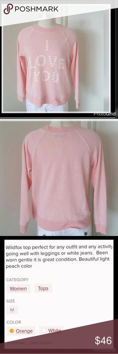 🔴Sale!! Wildfox Long Sleeve Peach Color Top Wildfox long sleeve I love you top. The hottest Brand in a long time. Certainly a much coveted item.  This beautiful peach color long sleeve I Love You pull over top is over-the-top in beauty. Worn, but in excellent condition. Please look closely at all photos and descriptions. Reposh item. Not returnable. Thank you. Please follow me to get price reduction notices. Length from shoulder to 23.4 inches. Sleeve from top of shoulder is 26 inches…