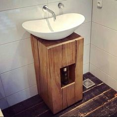 Big rustic oak log used as minimalistic bathroom furniture.
