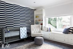 Modern Hamptons Nursery - WOW! How fab is this navy and white wallpaper accent wall?