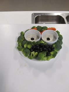 Oscar the grouch vegetable tray.  Broccoli, carrots, and olives.