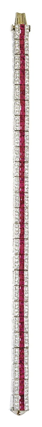 RUBY AND DIAMOND STRAIGHTLINE BRACELET, TIFFANY & CO, CIRCA 1925 The articulated band set with a line of 75 square-cut rubies bordered on either side by single-cut diamonds weighing approximately 4.00 carats, mounted in platinum, length 7¼ inches, signed Tiffany & Co.