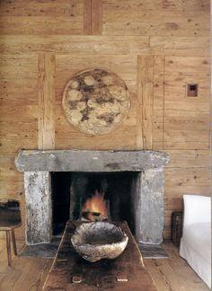 Wood wall paneling in pattern: Primitive Granite Mantle; Antique primitive table. Axel Vervoordt - Veranda