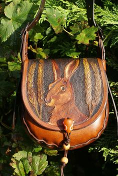 small boho-style bag with hand carved and coloured hare amongst ears of wheat design. I bought this bag, it's beautiful!